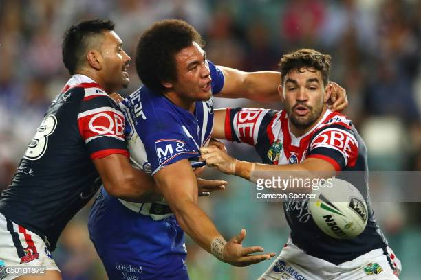 Raymond FaitalaMariner of the Bulldogs offloads the ball in a tackle during the round two NRL match between the Sydney Roosters and the Canterbury...