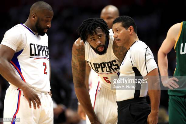 Raymond Felton and DeAndre Jordan of the Los Angeles Clippers talk with Referee Bill Kennedy during the second half of Game Seven of the Western...