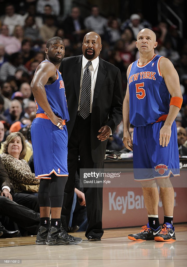 Raymond Felton #2 and Jason Kidd #5 of the New York Knicks listen as head coach Mike Woodson details the next play during a break in the action against the Cleveland Cavaliers at The Quicken Loans Arena on March 4, 2013 in Cleveland, Ohio.