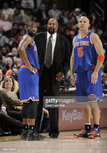 Raymond Felton and Jason Kidd of the New York Knicks listen as head coach Mike Woodson details the next play during a break in the action against the...