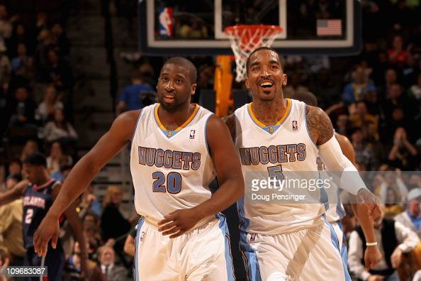 Raymond Felton and JR Smith of the Denver Nuggets celebrate after connecting to score against the Atlanta Hawks during NBA action at the Pepsi Center...