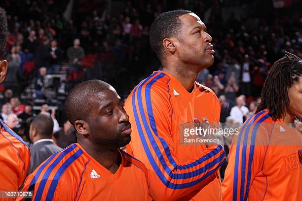 Raymond Felton and Marcus Camby of the New York Knicks listen to the Star Spangle Banner Prior to the game against the Portland Trail Blazers on...