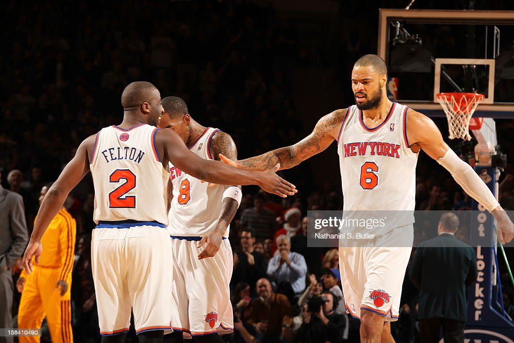 <a gi-track='captionPersonalityLinkClicked' href=/galleries/search?phrase=Raymond+Felton&family=editorial&specificpeople=209141 ng-click='$event.stopPropagation()'>Raymond Felton</a> #2 and <a gi-track='captionPersonalityLinkClicked' href=/galleries/search?phrase=Tyson+Chandler&family=editorial&specificpeople=202061 ng-click='$event.stopPropagation()'>Tyson Chandler</a> #6 of the New York Knicks celebrate during the game against the Cleveland Cavaliers on December 15, 2012 at Madison Square Garden in New York City.