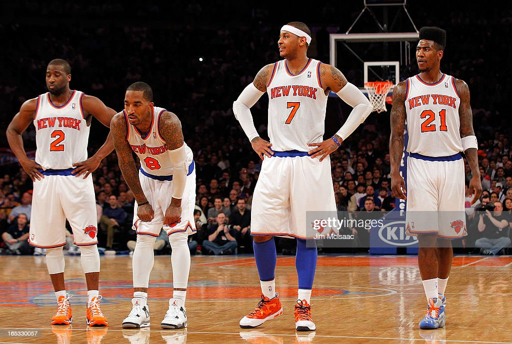 Raymond Felton #2, J.R. Smith #8, Carmelo Anthony #7 and Iman Shumpert #21 of the New York Knicks look on against the Memphis Grizzlies at Madison Square Garden on March 27, 2013 in New York City. The Knicks defeated the Grizzlies 108-101.