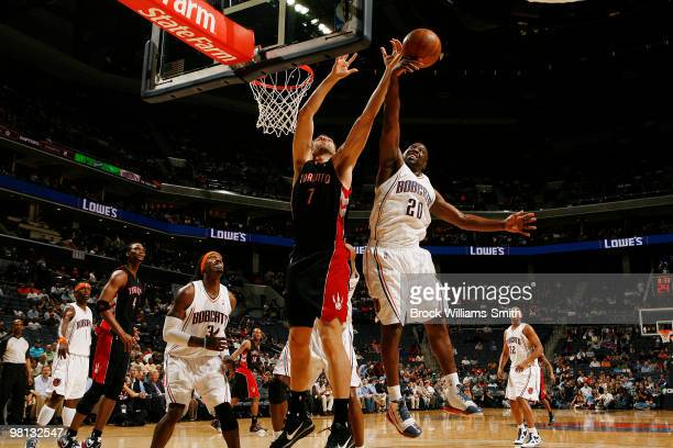 Raymond Felton of the Charlotte Bobcats blocks against Andrea Bargnani of the Toronto Raptors on March 29 2010 at the Time Warner Cable Arena in...