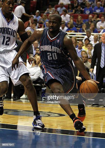 Raymond Felton of the Charlotte Bobcats drives around Dwight Howard of the Orlando Magic in Game Two of the Eastern Conference Quarterfinals during...