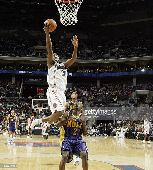 Raymond Felton of the Charlotte Bobcats goes for the layup against Darren Collison of the New Orleans Hornets on February 6 2010 at the Time Warner...