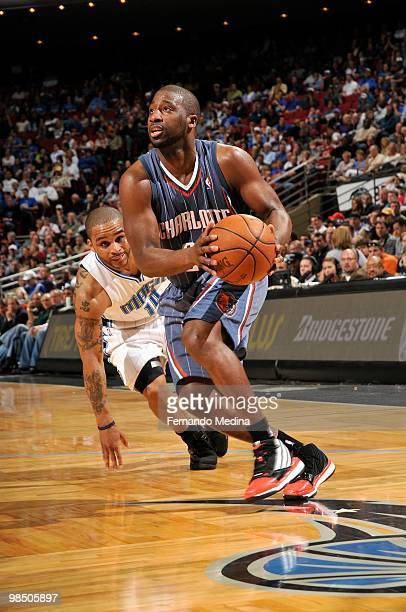 Raymond Felton of the Charlotte Bobcats moves the ball past Jameer Nelson of the Orlando Magic during the game on March 14 2010 at Amway Arena in...