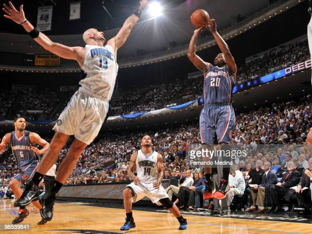 Raymond Felton of the Charlotte Bobcats shoots against Marcin Gortat of the Orlando Magic in Game One of the Eastern Conference Quarterfinals during...