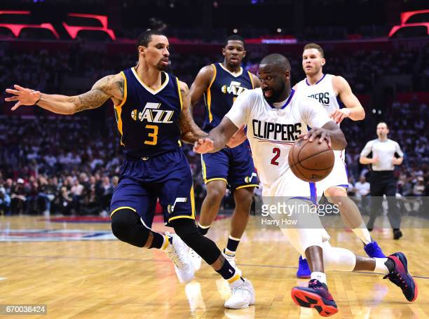 Raymond Felton of the LA Clippers drives to the basket on George Hill of the Utah Jazz during the first half in Game Two of the Western Conference...