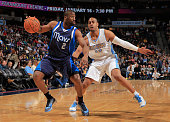 Raymond Felton of the Dallas Mavericks controls the ball against Arron Afflalo of the Denver Nuggets at Pepsi Center on January 14 2015 in Denver...