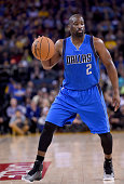 Raymond Felton of the Dallas Mavericks dribbles the ball against the Golden State Warriors at ORACLE Arena on February 4 2015 in Oakland California