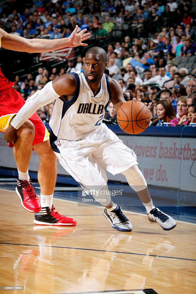 <a gi-track='captionPersonalityLinkClicked' href=/galleries/search?phrase=Raymond+Felton&family=editorial&specificpeople=209141 ng-click='$event.stopPropagation()'>Raymond Felton</a> #2 of the Dallas Mavericks drives against the Houston Rockets on October 7, 2014 at the American Airlines Center in Dallas, Texas.