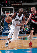 Raymond Felton of the Dallas Mavericks drives against the Portland Trail Blazers on April 15 2015 at the American Airlines Center in Dallas Texas...