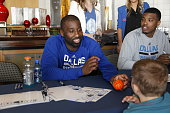 Raymond Felton of the Dallas Mavericks signs autographs for fans during the Dallas Mavericks 'Fan Jam' on October 4 2014 at the American Airlines...