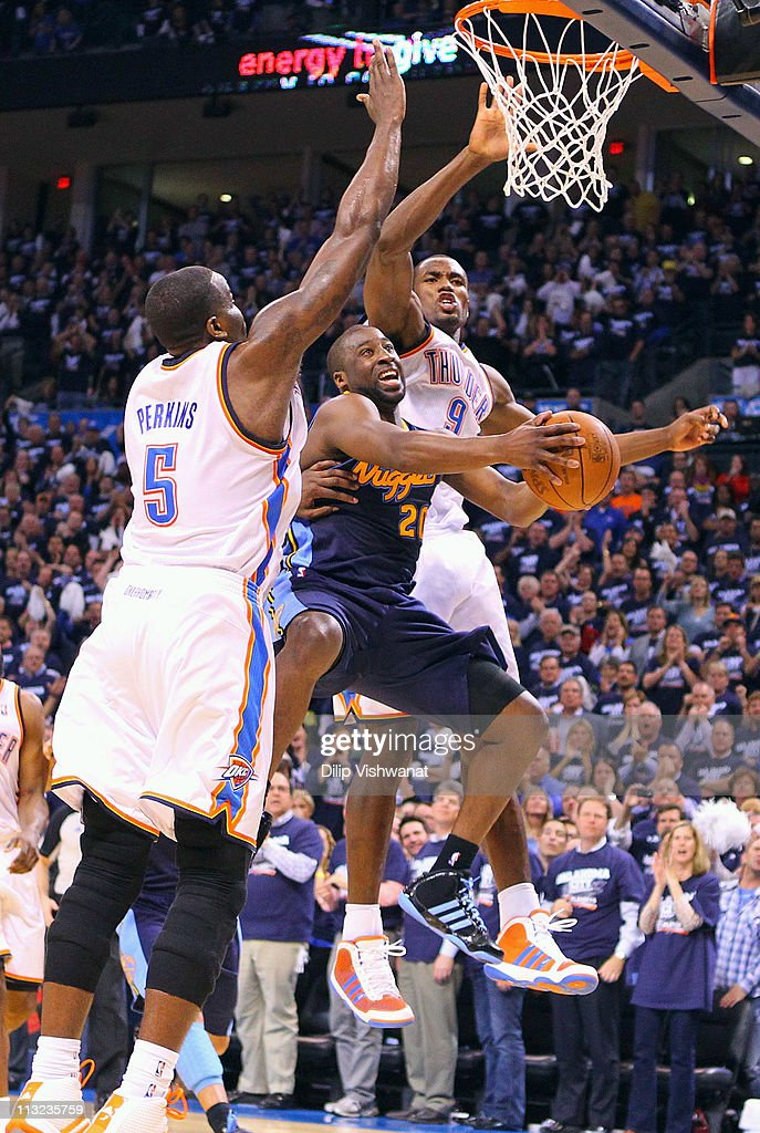 <a gi-track='captionPersonalityLinkClicked' href=/galleries/search?phrase=Raymond+Felton&family=editorial&specificpeople=209141 ng-click='$event.stopPropagation()'>Raymond Felton</a> #20 of the Denver Nuggets drives to the basket against <a gi-track='captionPersonalityLinkClicked' href=/galleries/search?phrase=Kendrick+Perkins&family=editorial&specificpeople=211461 ng-click='$event.stopPropagation()'>Kendrick Perkins</a> #5 and <a gi-track='captionPersonalityLinkClicked' href=/galleries/search?phrase=Serge+Ibaka&family=editorial&specificpeople=5133378 ng-click='$event.stopPropagation()'>Serge Ibaka</a> #9 \both of the Oklahoma City Thunder in Game Five of the Western Conference Quarterfinals in the 2011 NBA Playoffs on April 27, 2011 at the Ford Center in Oklahoma City, Oklahoma.