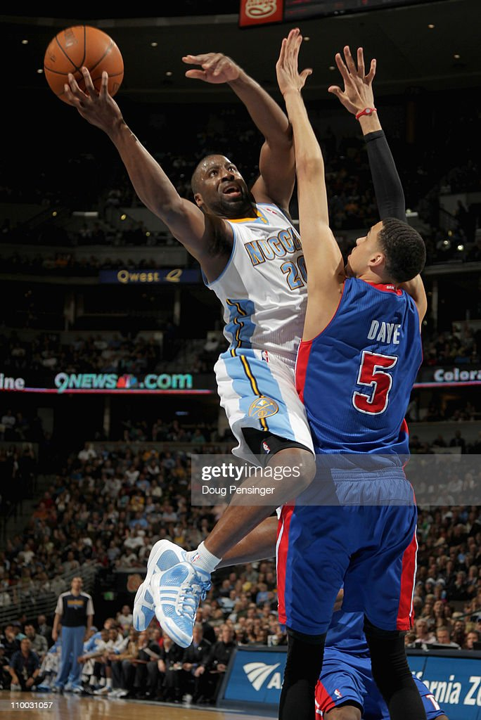 Raymond Felton #20 of the Denver Nuggets goes up for a shot and is fouled by Austin Daye #5 of the Detroit Pistons as he goes to the basket at the Pepsi Center on March 12, 2011 in Denver, Colorado. The Nuggets defeated the Pistons 131-101.