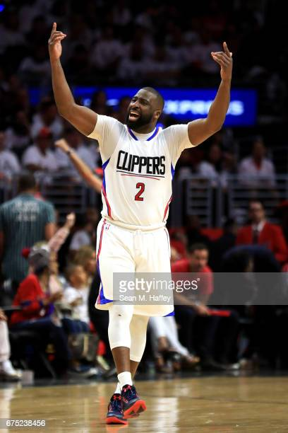 Raymond Felton of the Los Angeles Clippers motions to the crowd during the second half of Game Seven of the Western Conference Quarterfinals against...