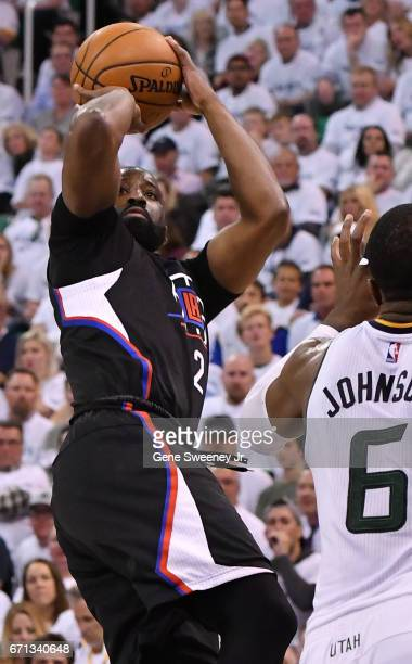 Raymond Felton of the Los Angeles Clippers shoots over Joe Johnson of the Utah Jazz in the second half of the Clippers 111106 victory in Game Three...