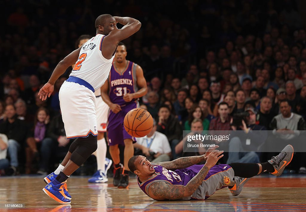 <a gi-track='captionPersonalityLinkClicked' href=/galleries/search?phrase=Raymond+Felton&family=editorial&specificpeople=209141 ng-click='$event.stopPropagation()'>Raymond Felton</a> #2 of the New York Knicks and Shannon Brown #26 of the Phoenix Suns battle for the ball at Madison Square Garden on December 2, 2012 in New York City.