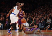 Raymond Felton of the New York Knicks and Shannon Brown of the Phoenix Suns battle for the ball at Madison Square Garden on December 2 2012 in New...