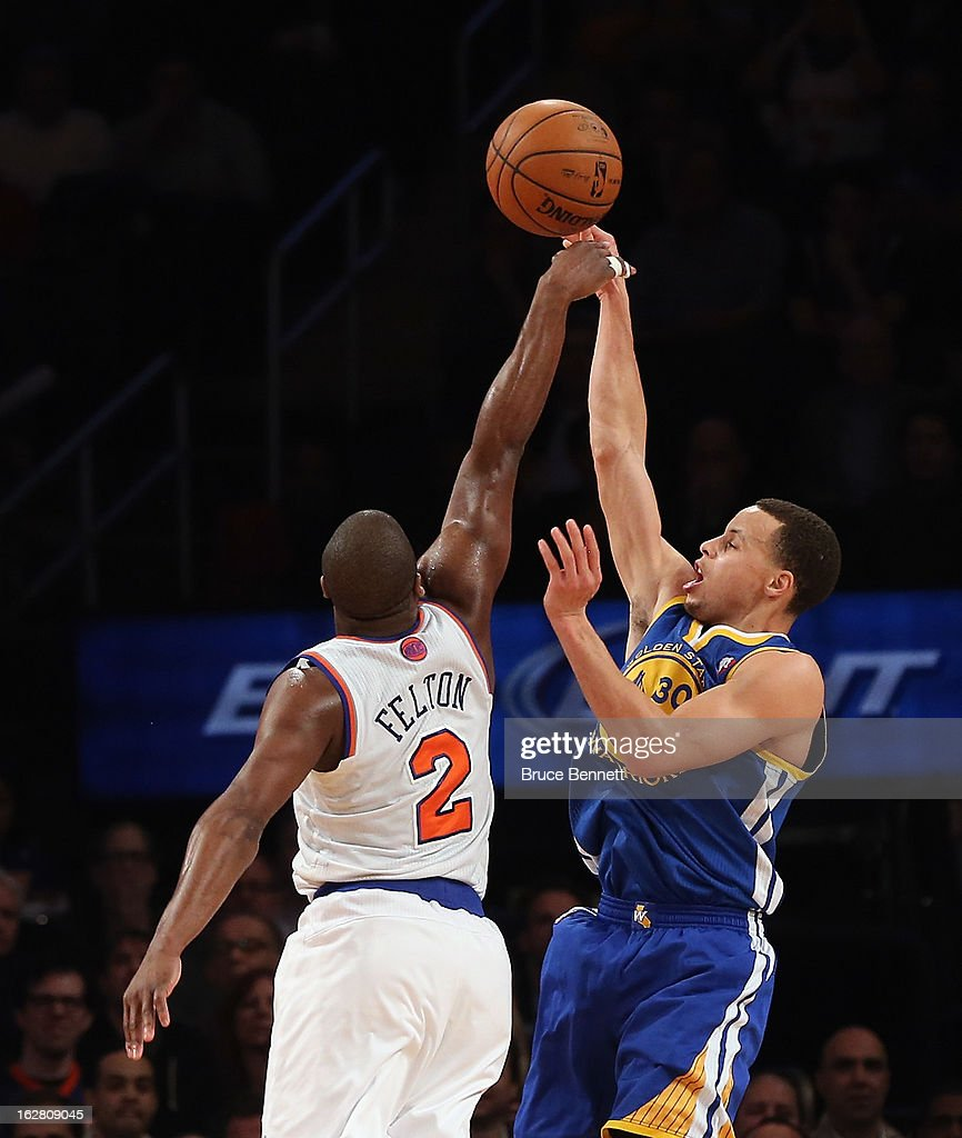 Raymond Felton #2 of the New York Knicks blocks a shot by Stephen Curry #30 of the Golden State Warriors in the fourth quarte at Madison Square Garden on February 27, 2013 in New York City.