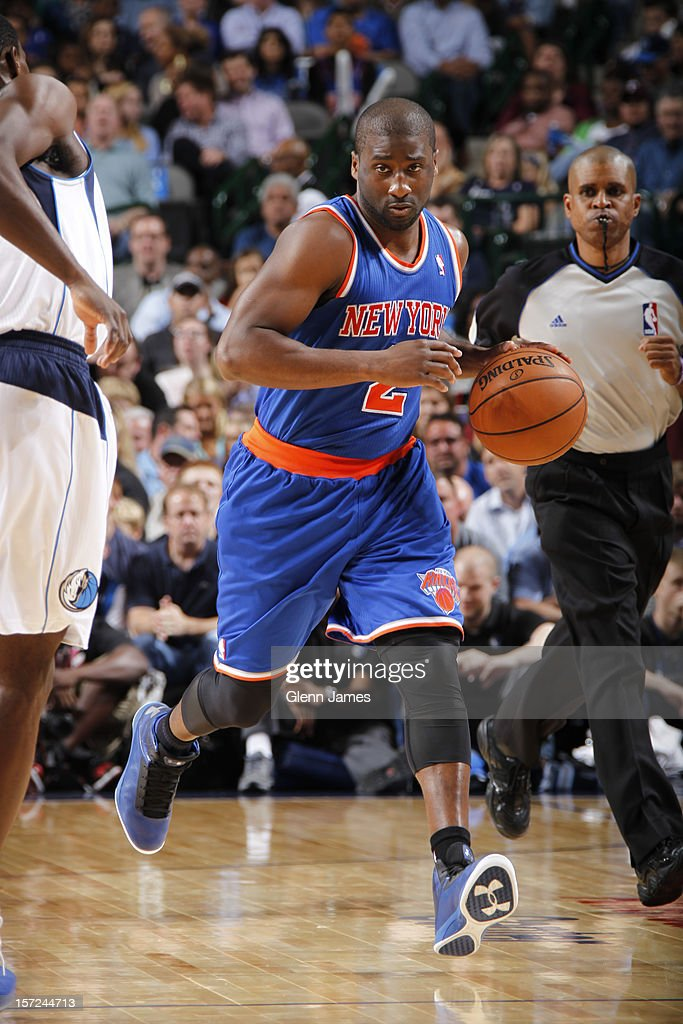 Raymond Felton #2 of the New York Knicks brings the ball up court against the Dallas Mavericks on November 21, 2012 at the American Airlines Center in Dallas, Texas.