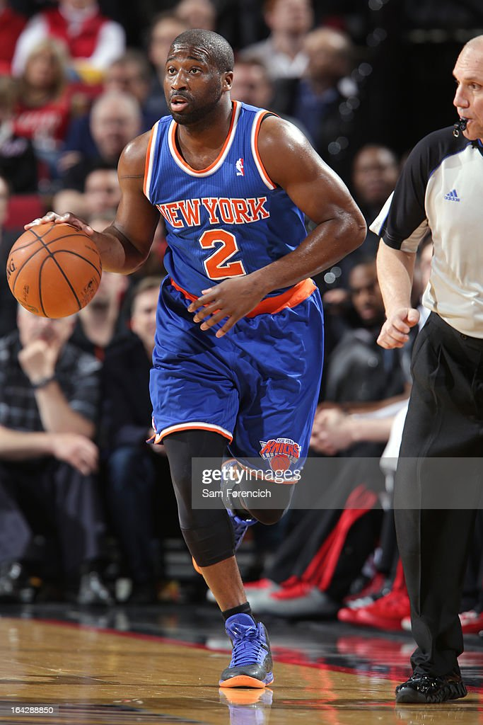 <a gi-track='captionPersonalityLinkClicked' href=/galleries/search?phrase=Raymond+Felton&family=editorial&specificpeople=209141 ng-click='$event.stopPropagation()'>Raymond Felton</a> #2 of the New York Knicks brings the ball up court against the Portland Trail Blazers on March 14, 2013 at the Rose Garden Arena in Portland, Oregon.