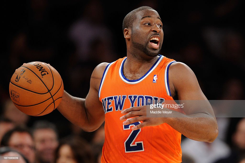<a gi-track='captionPersonalityLinkClicked' href=/galleries/search?phrase=Raymond+Felton&family=editorial&specificpeople=209141 ng-click='$event.stopPropagation()'>Raymond Felton</a> #2 of the New York Knicks carries the ball downcourt during the first half against the San Antonio Spurs at Madison Square Garden on November 10, 2013 in New York City. The Spurs defeat the Knicks 120-89.