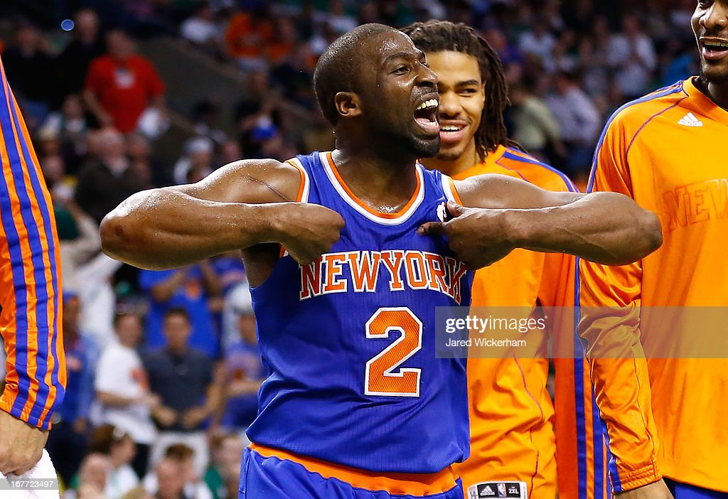 <a gi-track='captionPersonalityLinkClicked' href=/galleries/search?phrase=Raymond+Felton&family=editorial&specificpeople=209141 ng-click='$event.stopPropagation()'>Raymond Felton</a> #2 of the New York Knicks celebrates after making a three-point shot to end the third quarter against the Boston Celtics during Game Four of the Eastern Conference Quarterfinals of the 2013 NBA Playoffs on April 28, 2013 at TD Garden in Boston, Massachusetts.