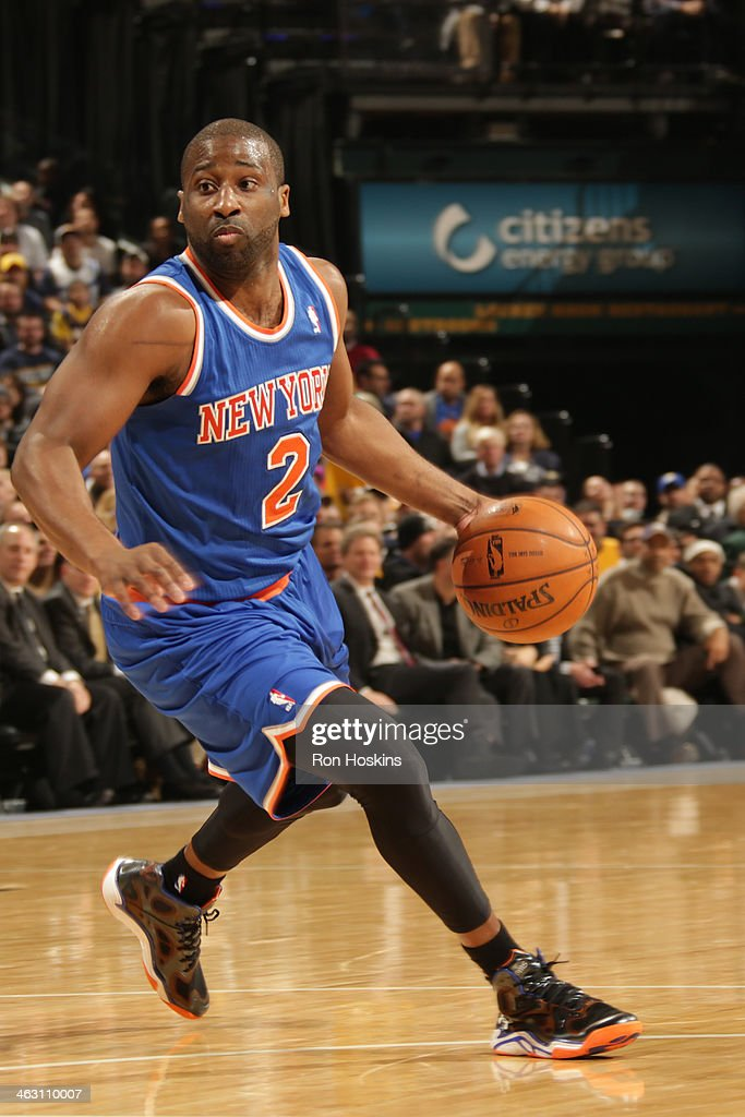 <a gi-track='captionPersonalityLinkClicked' href=/galleries/search?phrase=Raymond+Felton&family=editorial&specificpeople=209141 ng-click='$event.stopPropagation()'>Raymond Felton</a> #2 of the New York Knicks dribbles the ball against the Indiana Pacers at Bankers Life Fieldhouse on January 14, 2014 in Indianapolis, Indiana.
