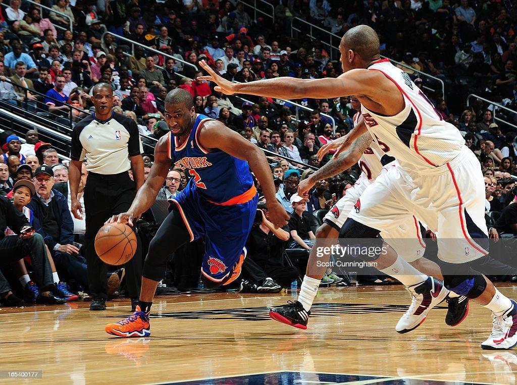 Raymond Felton #2 of the New York Knicks dribbles the ball to the basket against the Atlanta Hawks on April 3, 2013 at Philips Arena in Atlanta, Georgia.