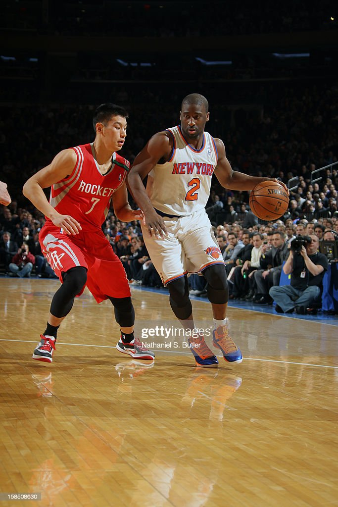 Raymond Felton #2 of the New York Knicks dribbles the ball while Jeremy Lin #7 of the Houston Rockets defends him on December 17, 2012 at Madison Square Garden in New York City.