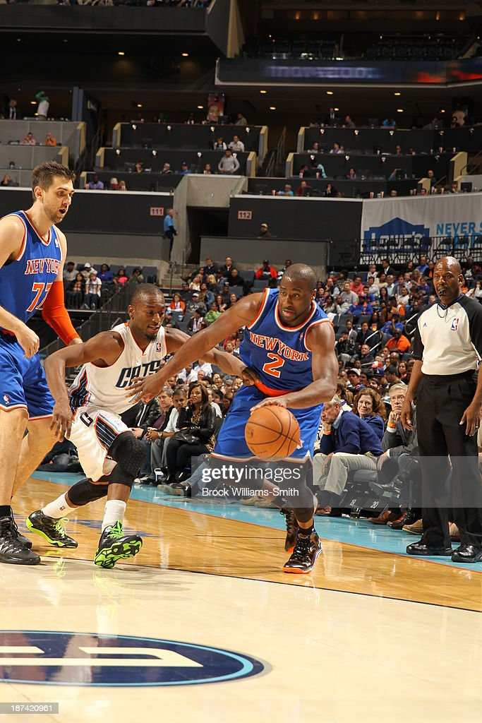 <a gi-track='captionPersonalityLinkClicked' href=/galleries/search?phrase=Raymond+Felton&family=editorial&specificpeople=209141 ng-click='$event.stopPropagation()'>Raymond Felton</a> #2 of the New York Knicks drives against <a gi-track='captionPersonalityLinkClicked' href=/galleries/search?phrase=Kemba+Walker&family=editorial&specificpeople=5042442 ng-click='$event.stopPropagation()'>Kemba Walker</a> #15 of the Charlotte Bobcats at the Time Warner Cable Arena on November 8, 2013 in Charlotte, North Carolina.