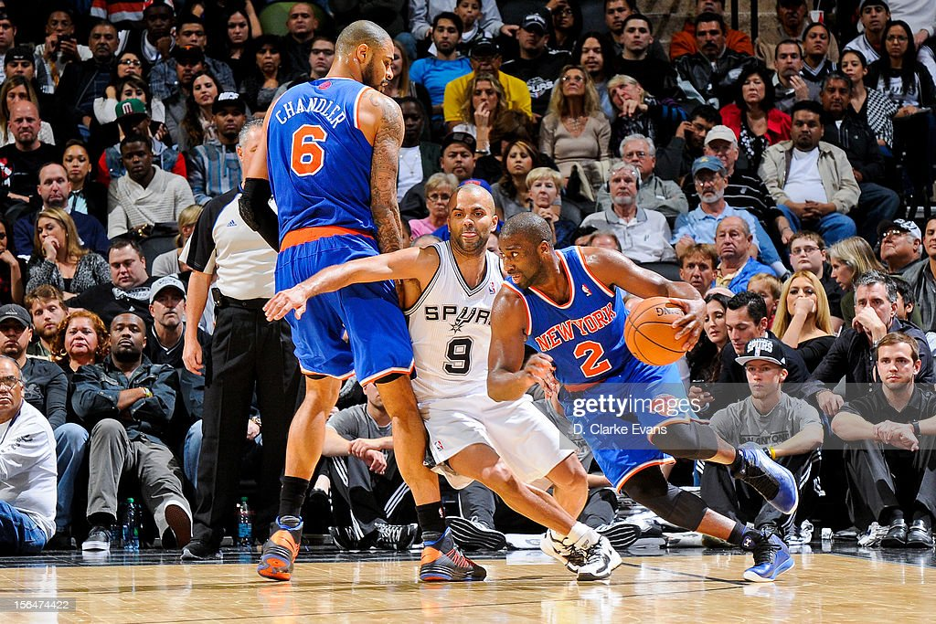 Raymond Felton #2 of the New York Knicks drives on a screen by teammate Tyson Chandler #6 against Tony Parker #9 of the San Antonio Spurs on November 15, 2012 at the AT&T Center in San Antonio, Texas.