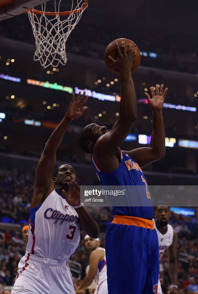 Raymond Felton #2 of the New York Knicks drives past Chris Paul #3 of the Los Angeles Clippers for a reverse layup in the first half at Staples Center on November 27, 2013 in Los Angeles, California.