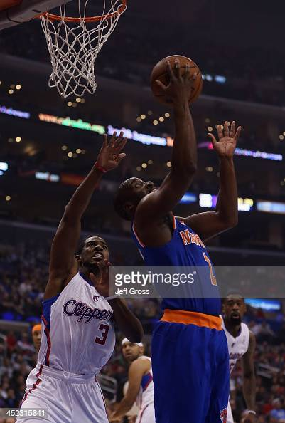 Raymond Felton of the New York Knicks drives past Chris Paul of the Los Angeles Clippers for a reverse layup in the first half at Staples Center on...