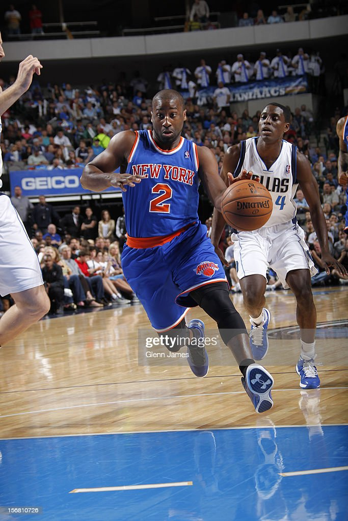 Raymond Felton #2 of the New York Knicks drives to the basket against Darren Collison #4 of the Dallas Mavericks on November 21, 2012 at the American Airlines Center in Dallas, Texas.