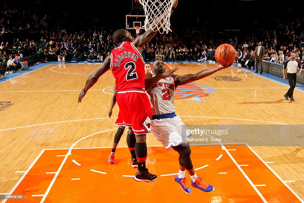 Raymond Felton #2 of the New York Knicks drives to the basket against Nate Robinson #2 of the Chicago Bulls on December 21, 2012 at Madison Square Garden in New York City.
