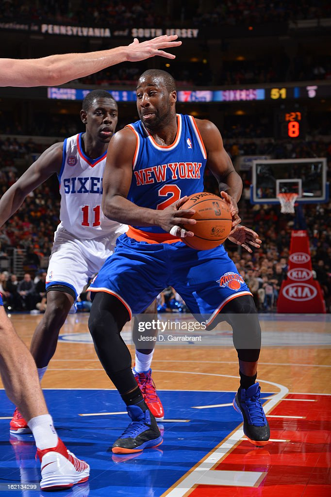<a gi-track='captionPersonalityLinkClicked' href=/galleries/search?phrase=Raymond+Felton&family=editorial&specificpeople=209141 ng-click='$event.stopPropagation()'>Raymond Felton</a> #2 of the New York Knicks drives to the basket against the Philadelphia 76ers at the Wells Fargo Center on January 26, 2013 in Philadelphia, Pennsylvania.