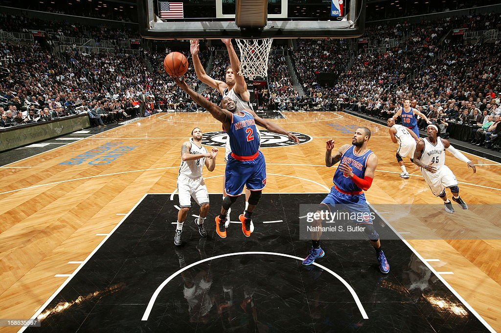 <a gi-track='captionPersonalityLinkClicked' href=/galleries/search?phrase=Raymond+Felton&family=editorial&specificpeople=209141 ng-click='$event.stopPropagation()'>Raymond Felton</a> #2 of the New York Knicks drives to the basket around <a gi-track='captionPersonalityLinkClicked' href=/galleries/search?phrase=Brook+Lopez&family=editorial&specificpeople=3847328 ng-click='$event.stopPropagation()'>Brook Lopez</a> #11 of the Brooklyn Nets on November 26, 2012 at the Barclays Center in the Brooklyn Borough of New York City.