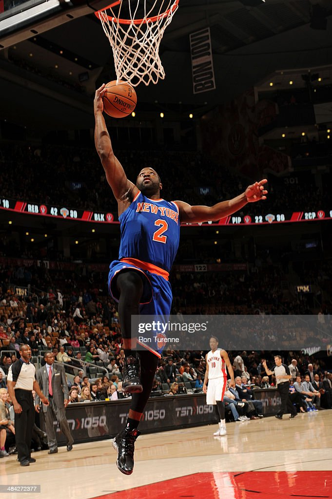 <a gi-track='captionPersonalityLinkClicked' href=/galleries/search?phrase=Raymond+Felton&family=editorial&specificpeople=209141 ng-click='$event.stopPropagation()'>Raymond Felton</a> #2 of the New York Knicks dunks against the Toronto Raptors on April 11, 2014 at the Air Canada Centre in Toronto, Ontario, Canada.