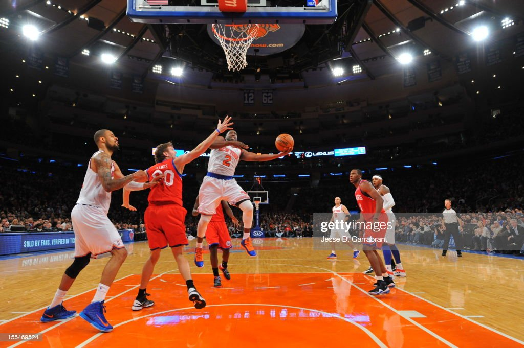 Raymond Felton #2 of the New York Knicks goes in for the easy layup vs Spencer Hawes #00 of the Philadelphia 76ers on November 4, 2012 at Madison Square Garden in New York City.