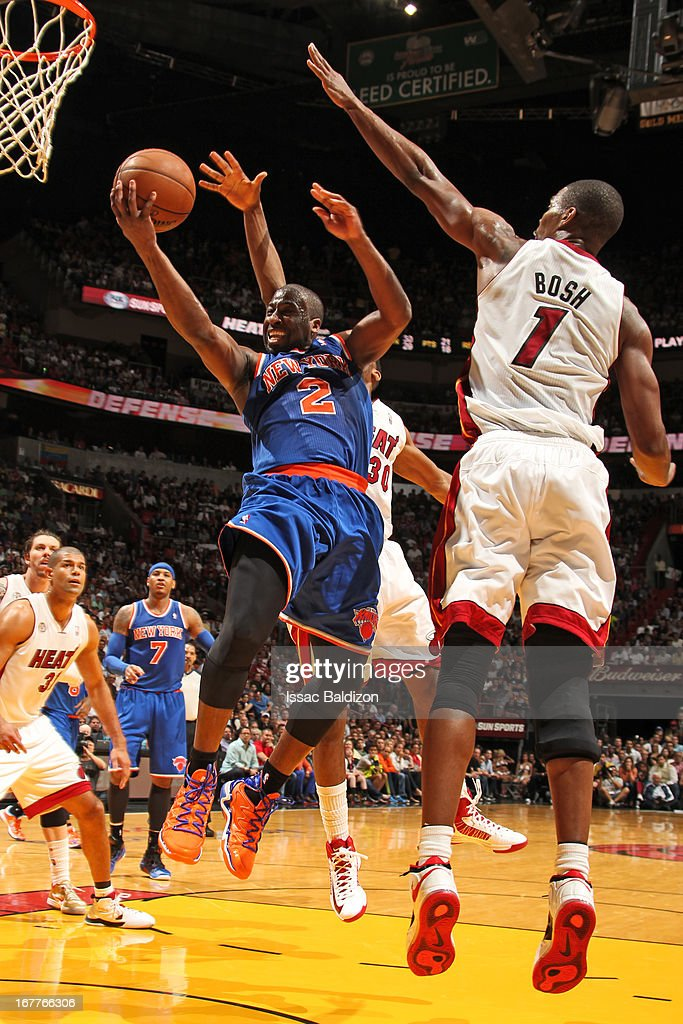 Raymond Felton #2 of the New York Knicks goes to the basket against Chris Bosh #1 of the Miami Heat on April 2, 2013 at American Airlines Arena in Miami, Florida.