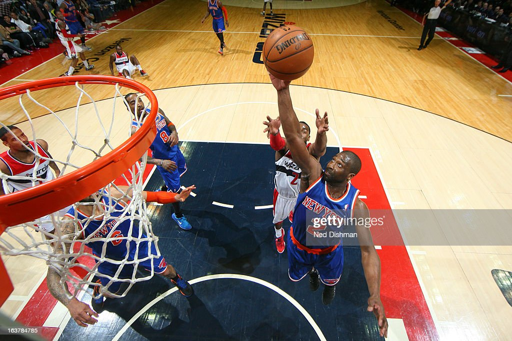 <a gi-track='captionPersonalityLinkClicked' href=/galleries/search?phrase=Raymond+Felton&family=editorial&specificpeople=209141 ng-click='$event.stopPropagation()'>Raymond Felton</a> #2 of the New York Knicks grabs a rebound against the Washington Wizards at the Verizon Center on March 1, 2013 in Washington, DC.
