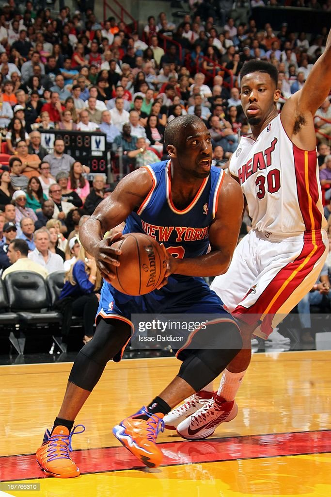 Raymond Felton #2 of the New York Knicks handles the ball against Norris Cole #30 of the Miami Heat on April 2, 2013 at American Airlines Arena in Miami, Florida.