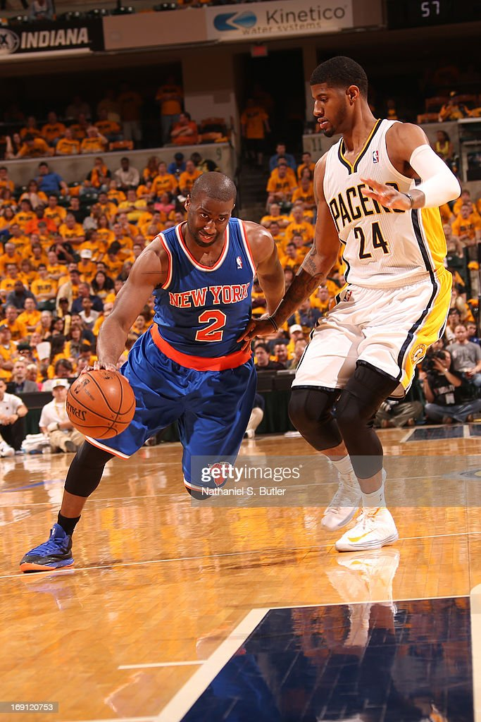 <a gi-track='captionPersonalityLinkClicked' href=/galleries/search?phrase=Raymond+Felton&family=editorial&specificpeople=209141 ng-click='$event.stopPropagation()'>Raymond Felton</a> #2 of the New York Knicks handles the ball against Paul George #24 of the Indiana Pacers in Game Six of the Eastern Conference Semifinals during the 2013 NBA Playoffs on May 18, 2013 at Bankers Life Fieldhouse in Indianapolis, Indiana.