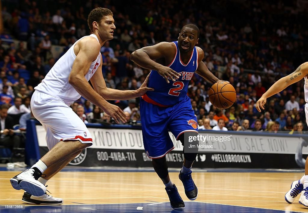 Raymond Felton #2 of the New York Knicks in action against Brook Lopez #11 of the Brooklyn Nets during a preseason game at Nassau Coliseum on October 24 2012 in Uniondale, New York The Knicks defeated the Nets 97-95.