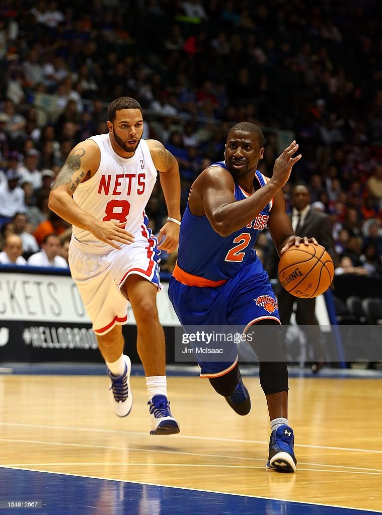 Raymond Felton #2 of the New York Knicks in action against Deron Williams #8 of the Brooklyn Nets during a preseason game at Nassau Coliseum on October 24 2012 in Uniondale, New York The Knicks defeated the Nets 97-95.