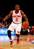 Raymond Felton of the New York Knicks in action against the Charlotte Bobcats during a preseason game at Madison Square Garden on October 25 2013 in...